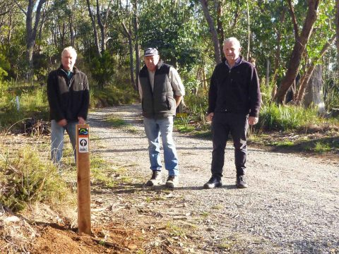 Joe Stellmann, a local landholder, with John Potter, from the Friends of the Heysen Trail, and helper Bill Gehling having installed the first Adelaide100 post.